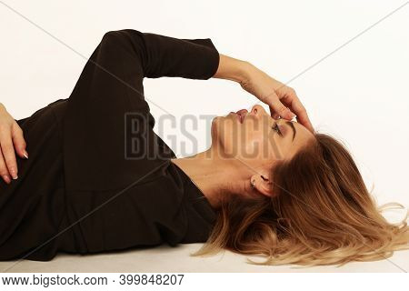 Blond Young Woman Lay On Floor Close Up Sensual Portrait