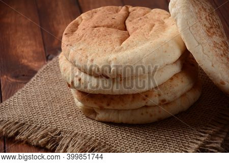 A Stack Of Pita Breads. Pita Bread On Wooden Board, Arabic Bread, Soft Baked Flatbreads. Popular Isr