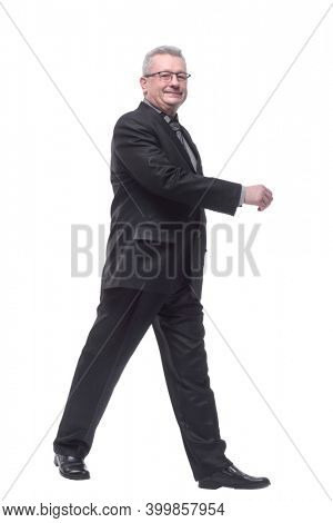 Happy business man smiling and walking and smiling - isolated ov