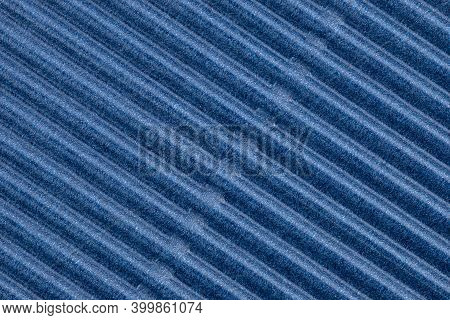 Background Made Of Blue Corrugated Cardboard With Diagonal Stripes, View From Above.