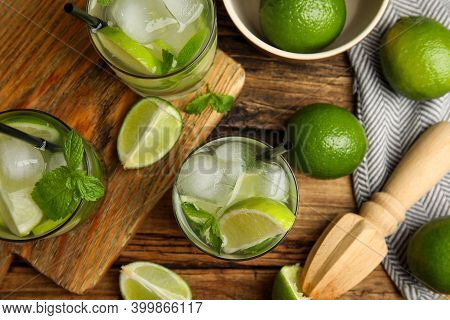 Delicious Mojito And Ingredients On Wooden Table, Flat Lay