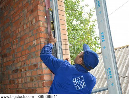 Kyiv, Ukraine - November 30, 2020: Professional Window Installer Is Checking With A Spirit Level If