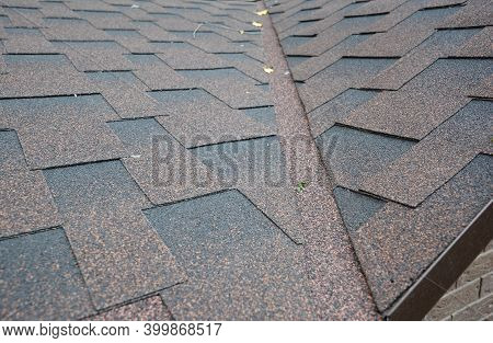 A Close-up Of Asphalt Shingled Roof Corner, Roof Intersection With Roof Flashing Installed To Preven