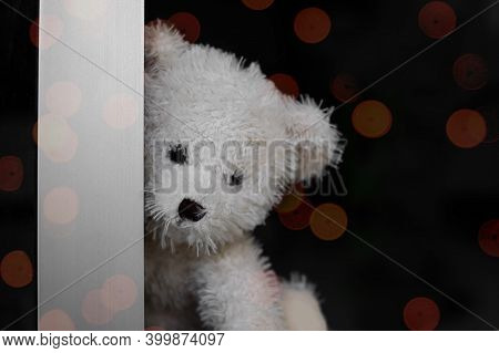 Broken Heart Or Loneliness Concept. Alone Teddy Bear Sit By The Door With Blur Bokeh. Symbol For Neg