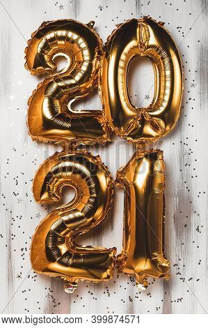 Happy New Year 2021 Celebration. Bright Gold Balloons Figures New Year Balloons With Glitter Stars O