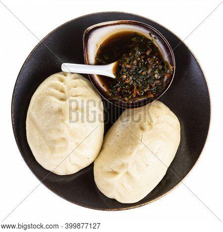 Top View Of Wang Mandu Pyanse (steamed Pie Stuffed With Vegetable And Meat In Korean Cuisine) On Bro