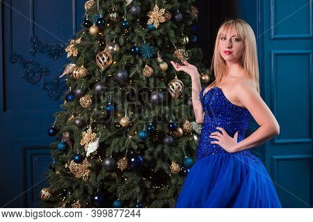 Woman In Evening Gorgeous Blue Dress. Pretty Nice Lady Indoor. Woman In Beautiful Dressy