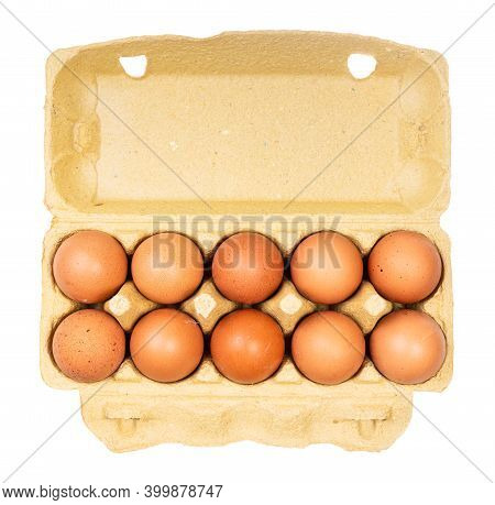 Top View Of Ten Brown Chicken Eggs (nine Brown Eggs And One White) In Yellow Paper Box Isolated On W