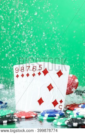 Straight Combination Under The Water Drops And Falling Poker Chips Against Green Background. Online
