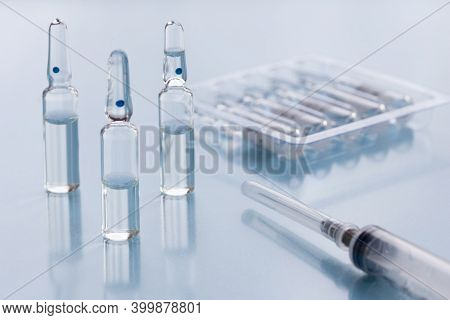 Packaging With Ampullas And Expendable Syringe For Vaccination. Coronavirus Vaccination Concept. Cov