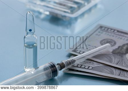 Packaging With Ampullas, Expendable Syringe For Vaccination And Paper Money. Coronavirus Vaccination
