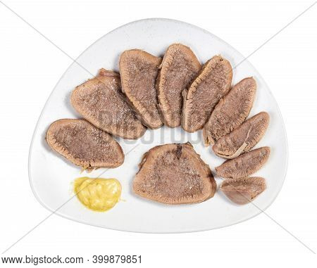 Top View Of Sliced Boiled Beef Tongue On White Plate Isolated On White Background