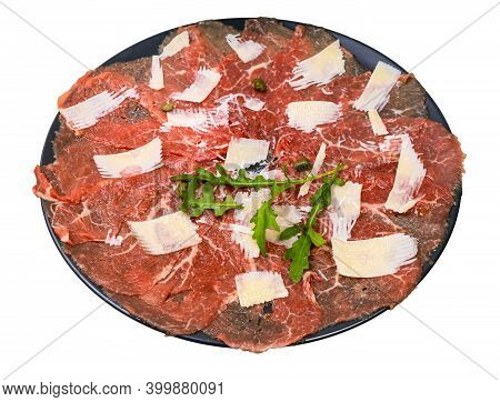 Served Carpaccio (thinly Sliced Raw Beef Fillet) Decorated By Parmesan, Arugula And Capers On Black