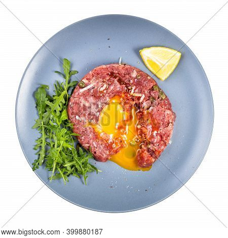 Top View Of Served Steak Tartare (raw Minced Beef Meat And Chopped Onion With Raw Yolk Decorated By
