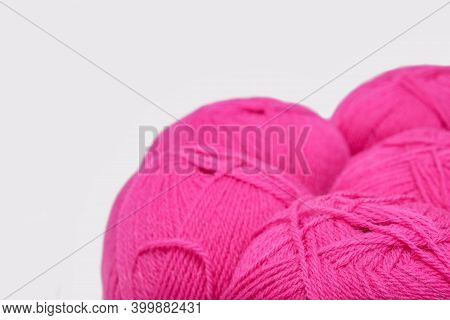 Red Pink Colorful Skeins Of Yarn Close Up, Fuchsia Color Woolen Yarn For Crochet And Knitting, Hobby