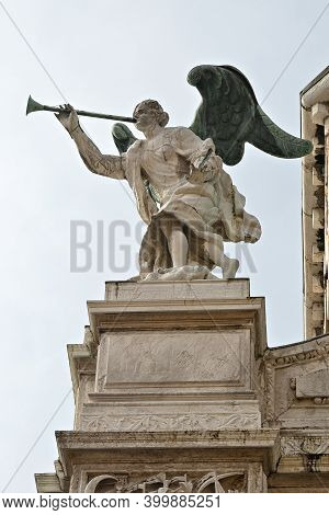The Angel Blew His Trumpet, Antique Decorations Statue On The Facade Of A Palace In Venice, Italy. B