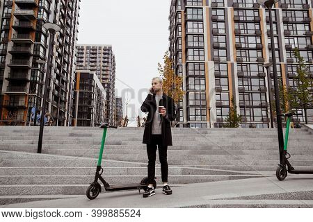Guy Rented Scooter. Autumn In Big City. Man In Casual Clothes Discusses Terms Of Renting Scooter By