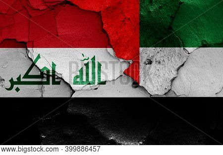 Flags Of Iraq And Uae Painted On Cracked Wall