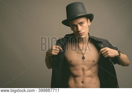 Young Handsome Man Shirtless Against Gray Background