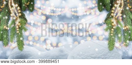 Christmas Tree Background Snow Decorated With Festive Garland Lights In Winter Wonderland