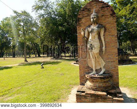 Sukhothai Thailand-28 November 2020:sukhothai Historical Park Phra Pang Leela Statue Is The Art Of S