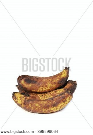 Closeup Of Rotten Banana Fruit Isolated On White Background In Vertical Orientation