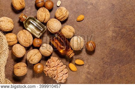 Natural Oil Macadamia Nuts Walnuts Pine Nuts Almonds. Copyspace. Healthy Product