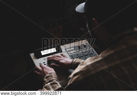 A Hip Hop Composer, Beatmaker Creates Beats On A Digital Production Controller With Pushbutton Pads.