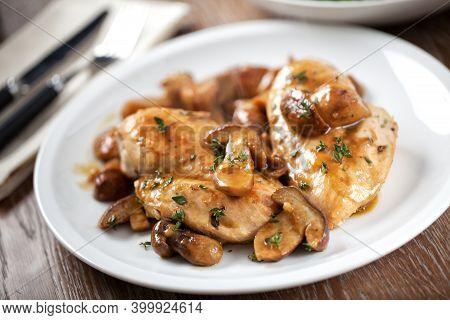 Grilled Chicken Breast With Mushrooms On A Plate