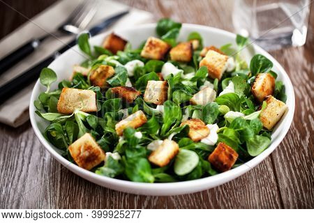 Delicious Caesar Salad With Homemade Croutons And Dressing.