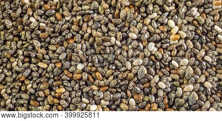 Chia Seeds Background Image. Black Chia Seeds Filling In The Picture. Healthy Food. Copy Space.