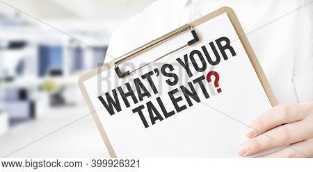 Text Whats Your Talent On White Paper Plate In Businessman Hands In Office. Business Concept