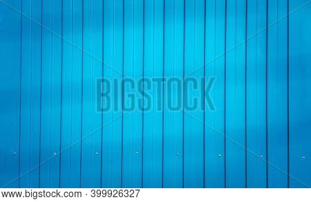 Blue Color Corrugated Zinc Fence, Closeup Glossy Metal Plate For Surrounding Wall Of Construction Si