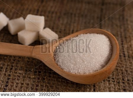 Pieces Of Lump Sugar On Burlap. Granulated Sugar Close-up. Refined Sugar. Sugar