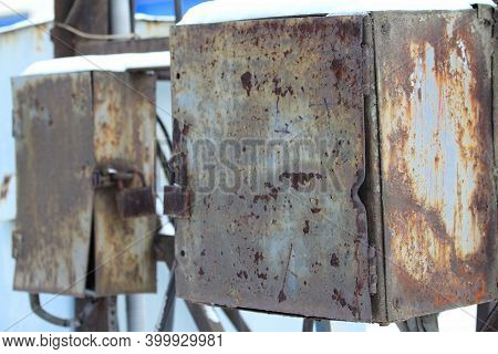 Old Street Metal Rusty Locked Box For Wires, Equipment, Tools, Industrial Background. Stock Photo Wi