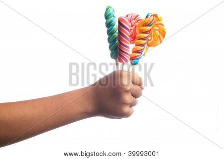 Child's hands holding candy