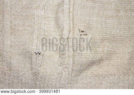 A Hole In The Knitted Fabric.the Background Is A Hole In The Sweater.