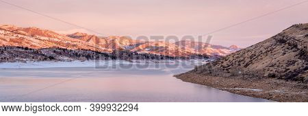 winter panorama of mountain lake at foothills of Rocky Mountains in surise light, Horsetooth Reservoir - a pupular recreational area in northern Colorado