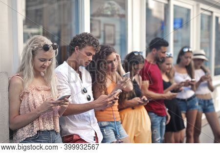group of young people chat with smartphone