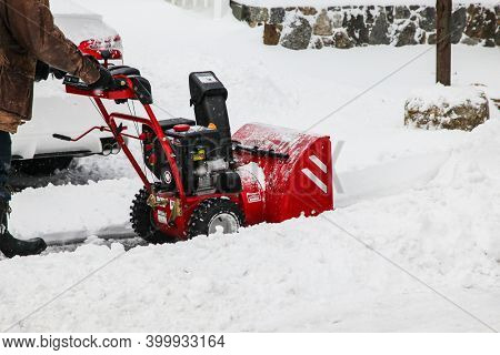 NORWALK, CT, USA-DECEMBER 17, 2020: Snow cleaning on Taylor Avenue after snow storm