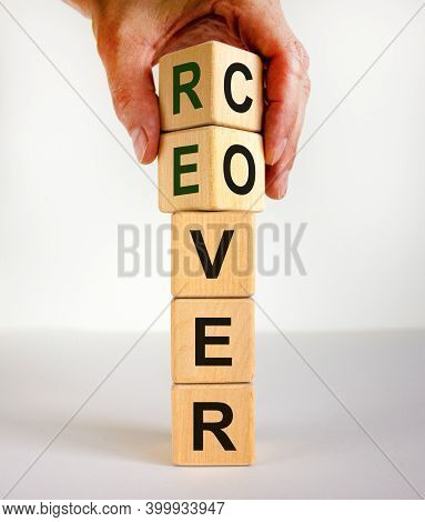 Time To Recover Symbol. The Word 'recover' On Wooden Cubes. Male Hand. Beautiful White Background, C