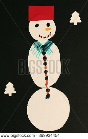 Seven Year Child's Drawing, Snowman Collage On Black Paper.