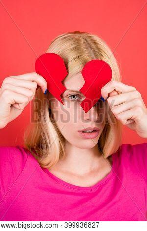 Break Of Relationships. Sad Woman With Broken Paper Heart In Hands. Unhappy Love. Love Concept. Red