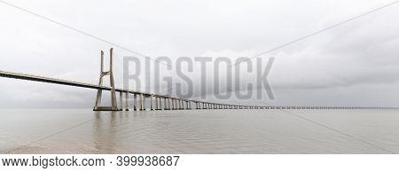 Panorama View Of The Vasco Da Gama Bridge In Lisbon
