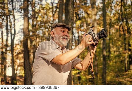 Autumn Session. Mature Photographer Shoot In Nature. Professional Photography Session. Landscape And