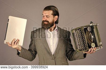 Man Working On Retro Typewriter In Library. Mechanical Vs Digital. Writer Writes With Typewriter And