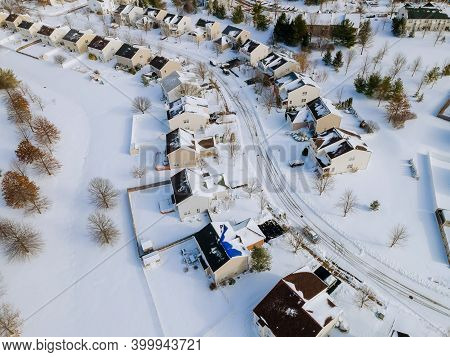 Aerial View Of Residential Houses Covered Snow With Snow On Covered Houses And Roads At Winter Seaso