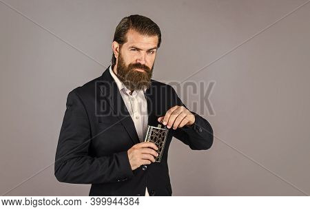 Man With His Booze Flask. Man Drinks Strong Alcohol From Iron Flask While Relaxing. Hip Flask For Wh