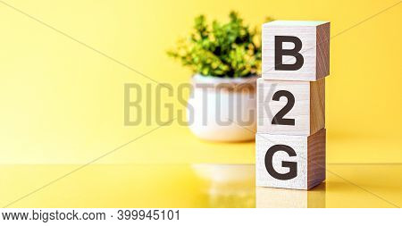 B2g - Acronym From Wooden Blocks With Letters, Concept. B2g - Business-to-government