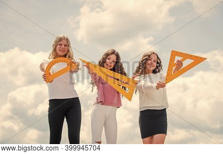 Exact Sciences. Three Girls With Protractor And Triangle Ruler. Back To School. Geometry Favorite Su